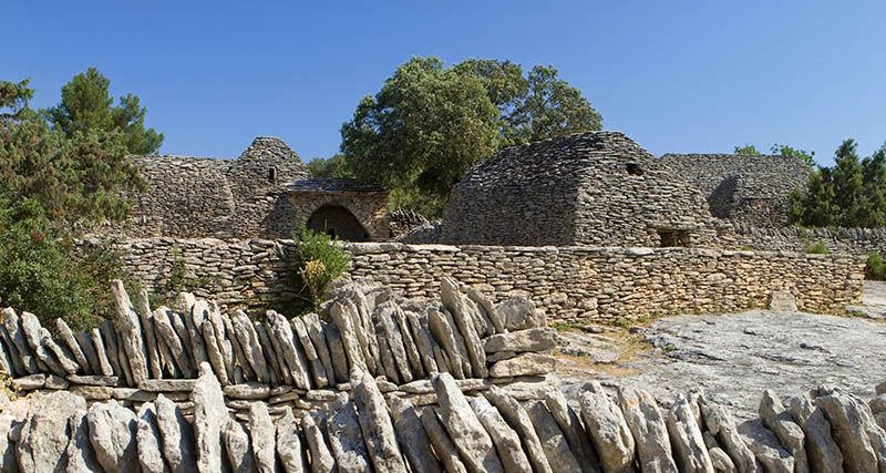 Stone houses in Bories Village, open-air museum, about 2 to 5 centuries old. Luberon Natural Park, near Gordes village, Vaucluse department, Provence-Alpes-Cote d'Azur region. France.