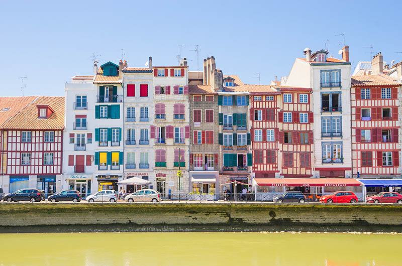 Old Houses along Nive River on a sunny day in Bayonne (France)