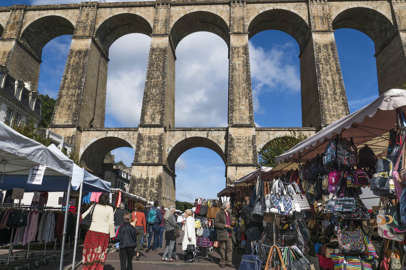 Morlaix, France - October 14, 2015: This is a large open air market held every Saturday in Morlaix France with people milling around shopping and looking for bargains amongst the various stalls.