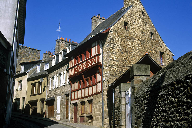 A typical paved street is lined with old half_timbered houses in Saint_Brieuc,a commune in the Cotes_d´Armor region in Brittany.