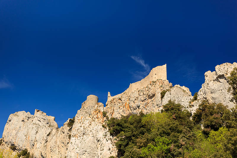 Closeup of the remains of an old stone cathar castle in the Pyrenees mountains in France