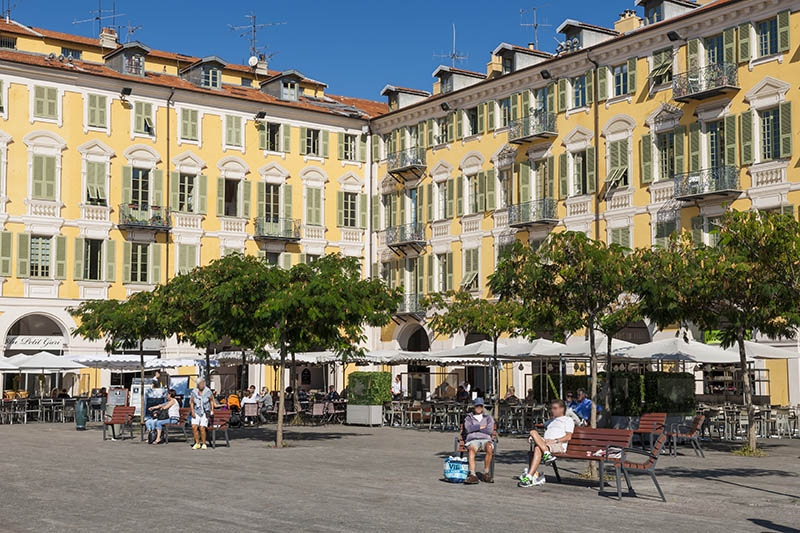 Nice, France - October 2, 2014: Restaurant patios at Place Garibaldi, one of the oldest and largest squares in the city.