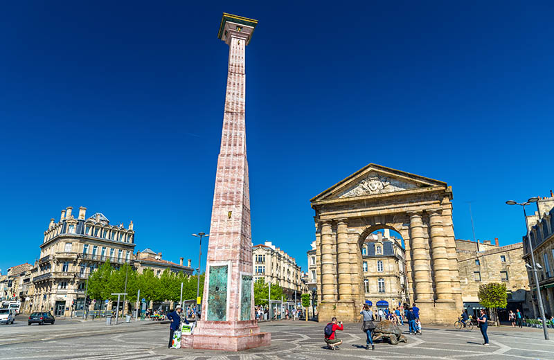 Bordeaux, France - April 9; 2017: The Obelisk and the Aquitaine Gate on Place de la Victoire square