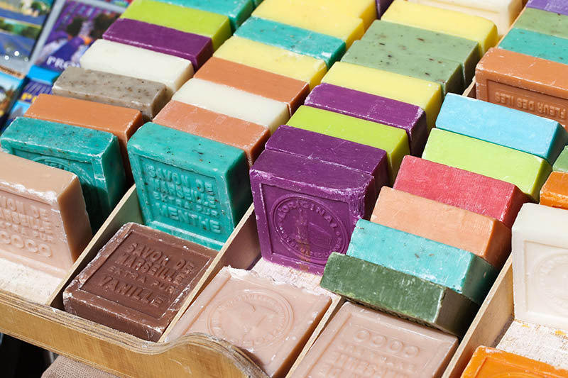 different flavored and colored bars of soap on a farmer's market