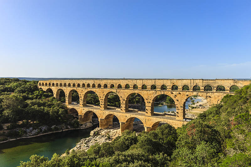 Pont du Gard is a Roman bridge at three levels built around 17 Ac, part of the Roman aqueduct with the same name that is became a UNESCO World Heritage Site in 1985.