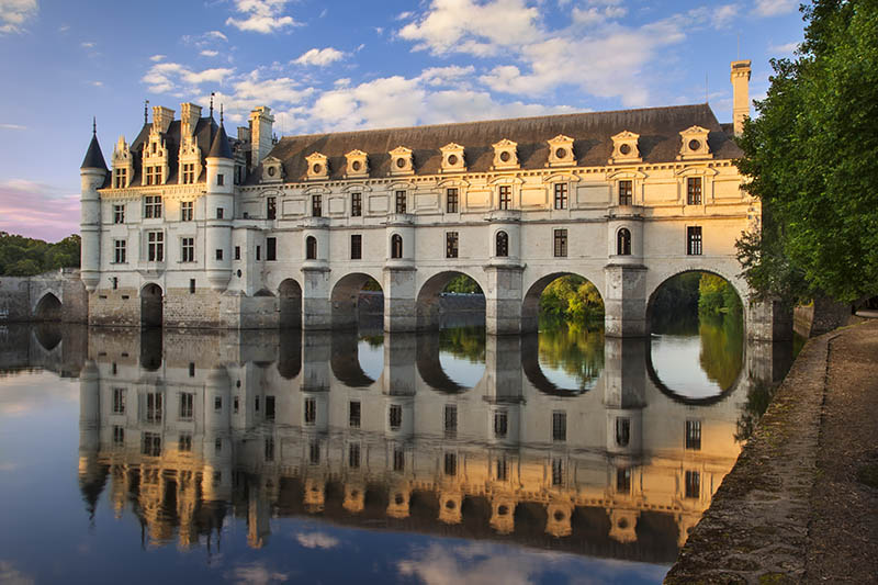Evening sunlight on Chateau Chenonceau and River Cher Indre-et-Loire Centre France