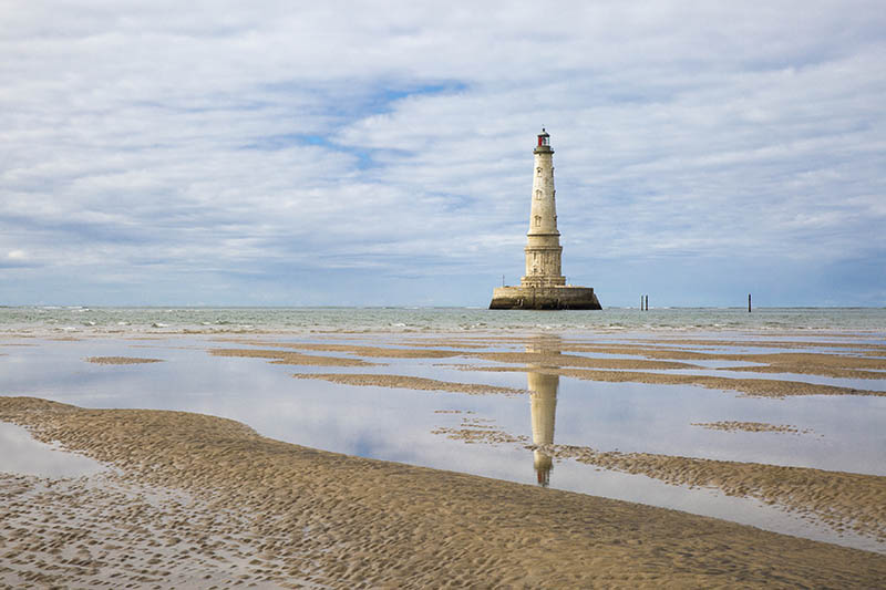 view of the historical lighthouse of Cordouan at low tide, Gironde estuary, France
