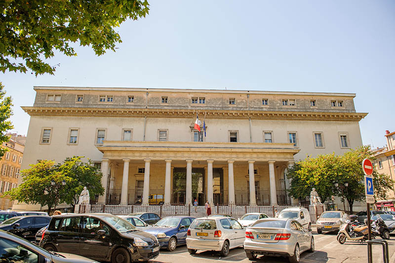 Aix-En-Provence, France - July 17, 2014: Cour d'appel d'Aix-en-Provence Palace of Justice of Aix-en-Provence on a sunny day with cars and pedestrians. The Palace is located in Place de Verdun