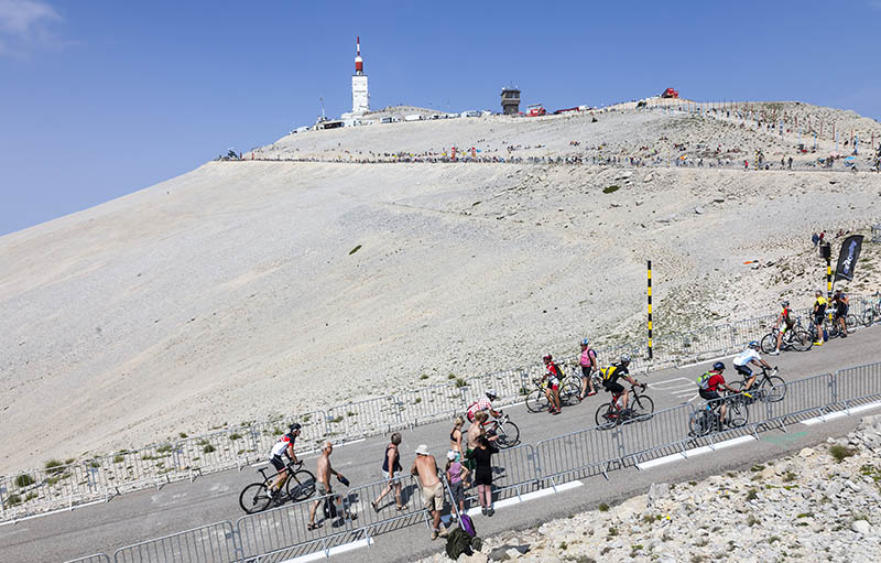 Mont Ventoux, France- July 14 2013: Amateur cyclists climbing the road to Mount Ventoux before the apparition of the competitiors in the stage 15 of the 100 edition of Le Tour de France 2013.