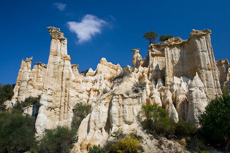 Natural chimneys made up of columns of soft rock, eroded by rain in Ille sur Tet, Languedoc Roussillon, France.