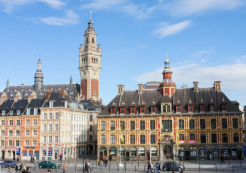 Lille, France - November 2, 2009: Unidentified people at the Chambre of Commerce and historical houses at the Place General de Gaulle in Lille, France.