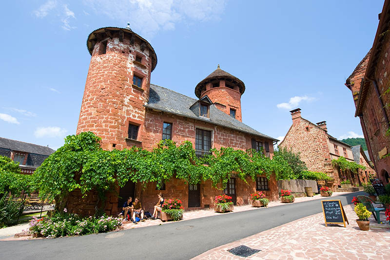 Collonges La Rouge, France - July 23, 2014: All the houses in the small picturesque city of Collonges la Rouge in France are built with red bricks