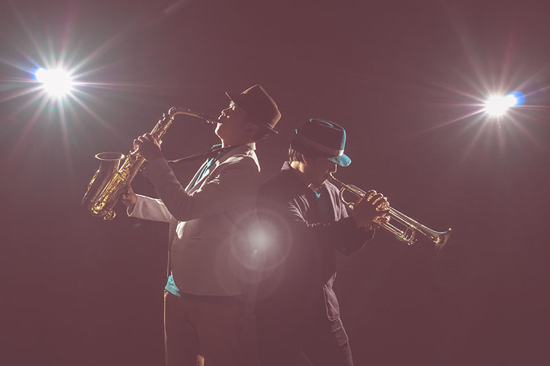 Musician Duo band playing the Trumpet with spot light and lens flare on the stage, musical concept